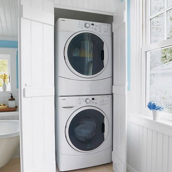 Hidden laundry cabinet for Master closet laundry room combo