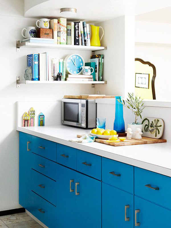 small kitchen with blue cabinet