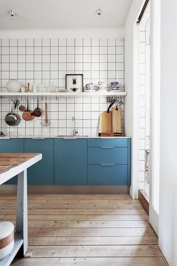 White kitchen in blue cabinet