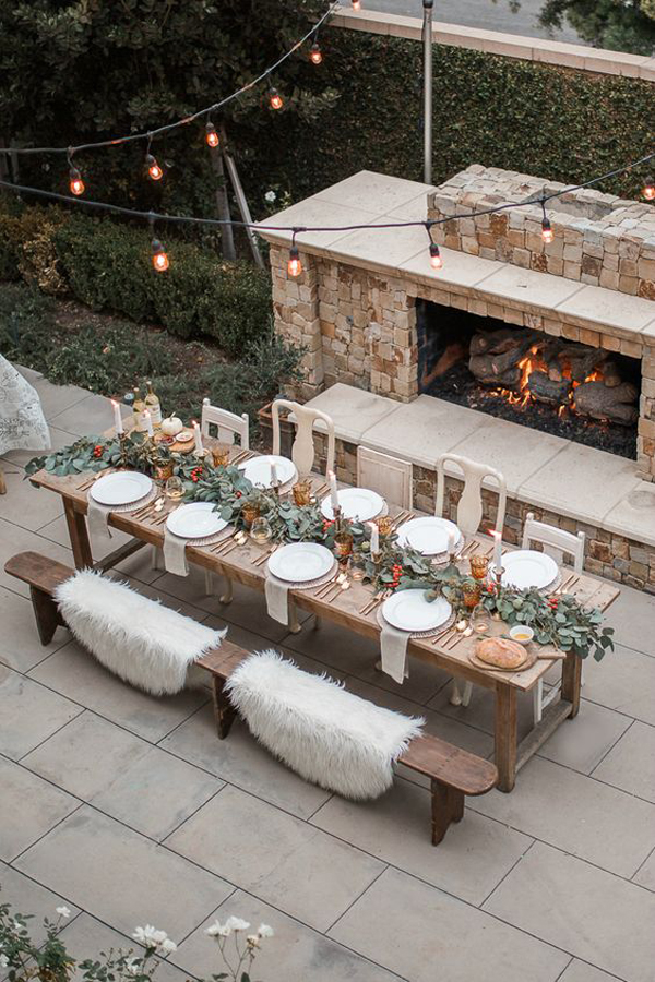 outdoor-dinner-party-with-stone-fireplace
