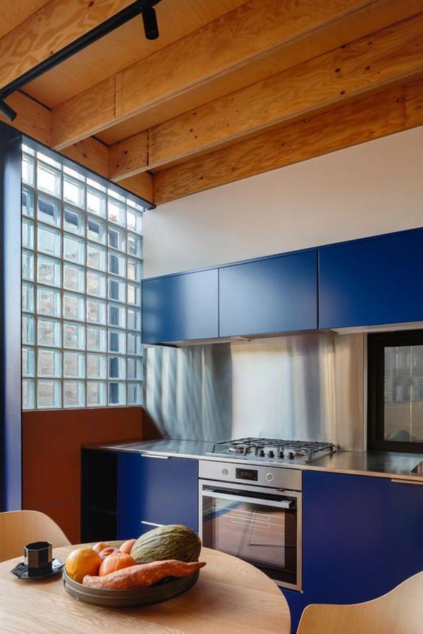 modern-blue-kitchen-interior-with-glass-block-wall