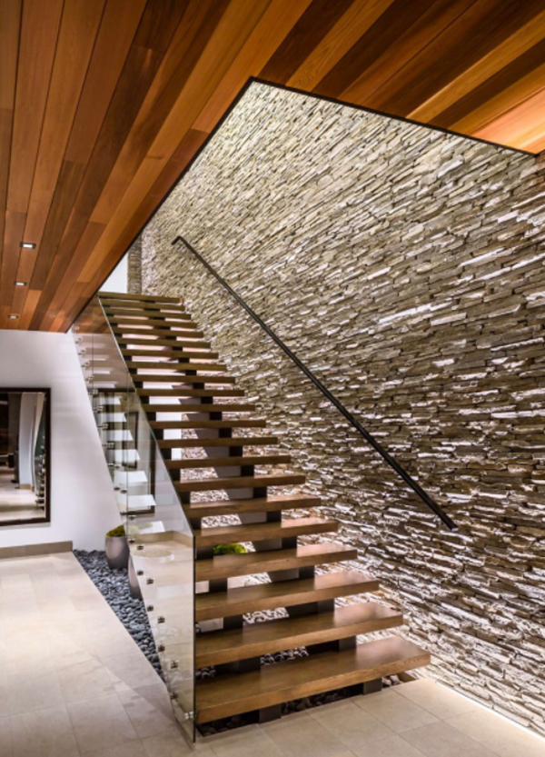 contempory-staircase-with-stone-wall