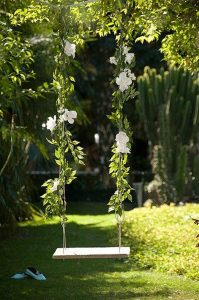 fresh-floral-tree-swing-for-wedding