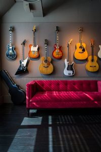 masculine-interior-with-guitar-display-wall