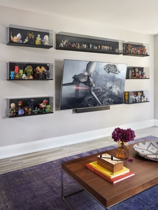 TV-wall-display-with-action-figure-backdrop