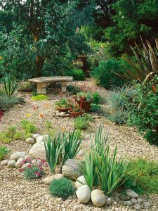farmhouse-garden-landscaping-with-gravel-and-river-rock
