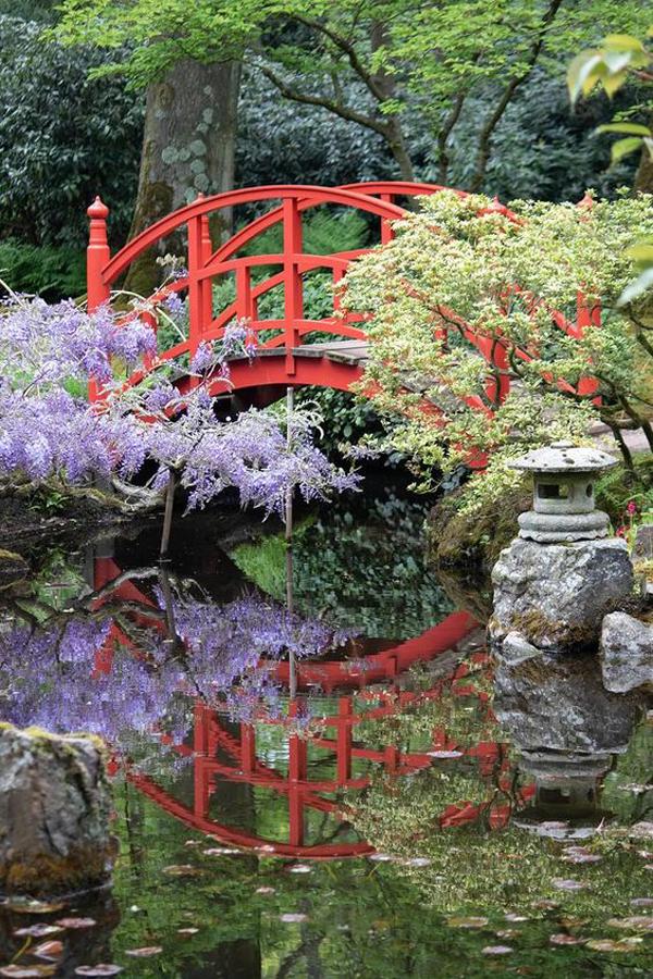 red-japanese-bridge-in-zen-garden