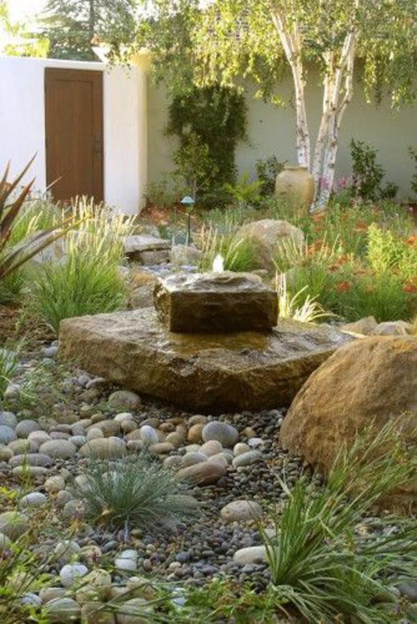 stone-fountain-concept-with-gravel-garden
