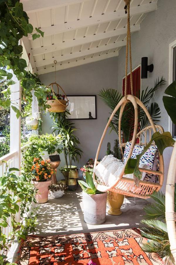 beautiful-boho-balcony-garden-with-hanging-rattan-chairs