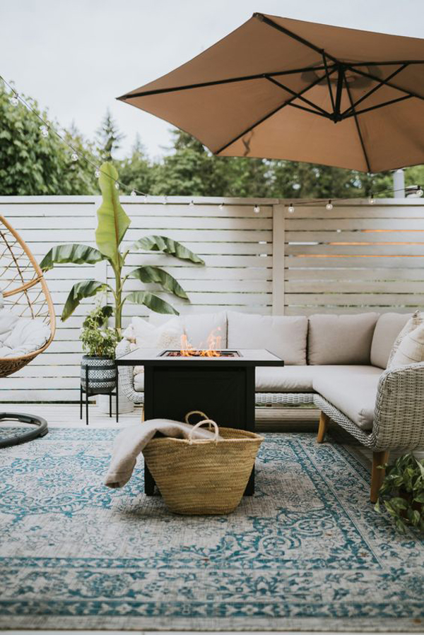 patio-deck-makeover-with-rug-and-fireplace-table