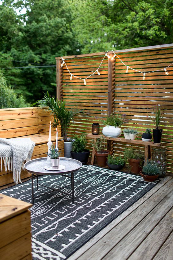 small-outdoor-deck-with-rugs