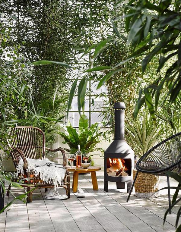 urban-jungle-patio-design-with-fireplace