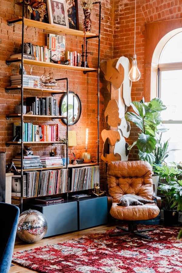 exposed-brick-reading-nook-with-bookcase