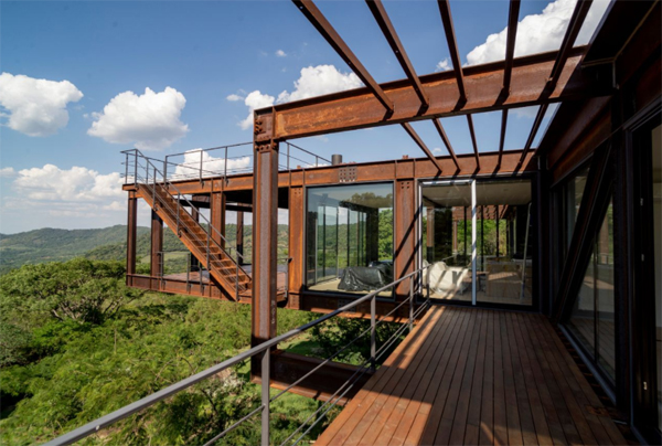 metal-and-wooden-floor-residence-with-mountains
