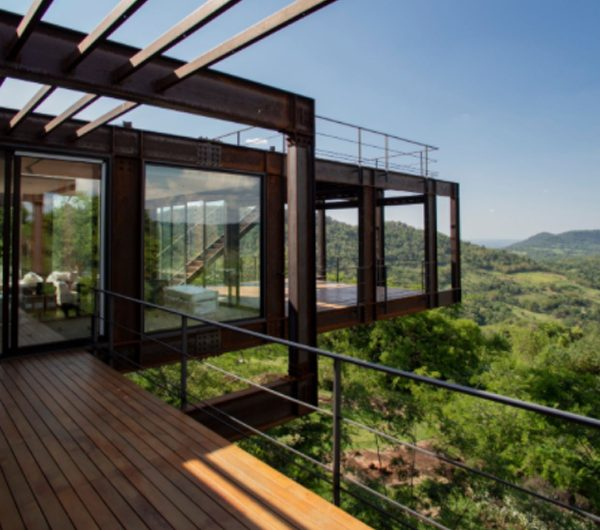 Metal Residence With View Of The Surrounding Mountains
