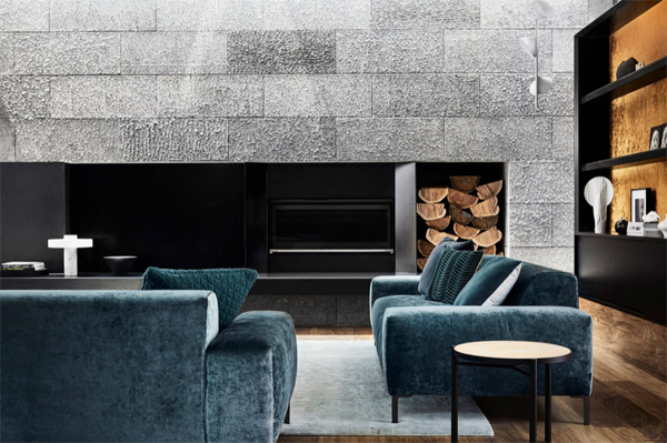 blue-sofa-design-with-modern-fireplace