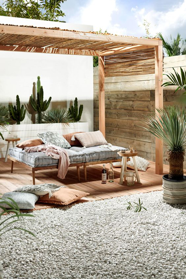 cozy-outdoor-retreat-with-wood-and-bamboo-pergolas