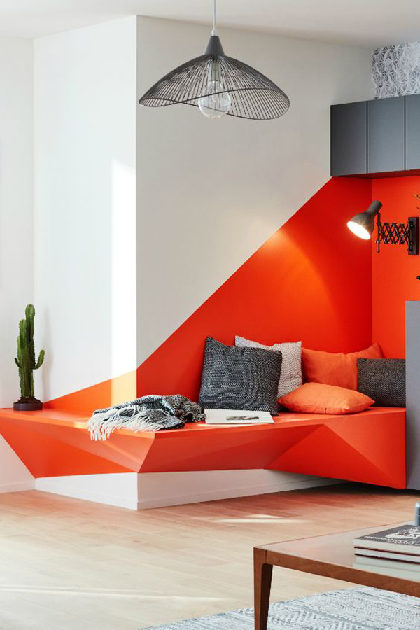 modern-reading-nook-with-red-accent-wall