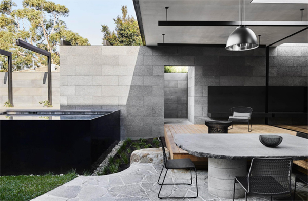 outdoor-concrete-dining-space-with-pool