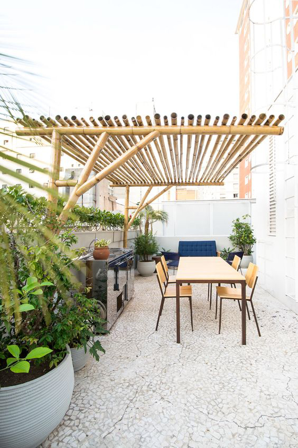 outdoor-kitchen-and-dining-area-with-bamboo-pergolas