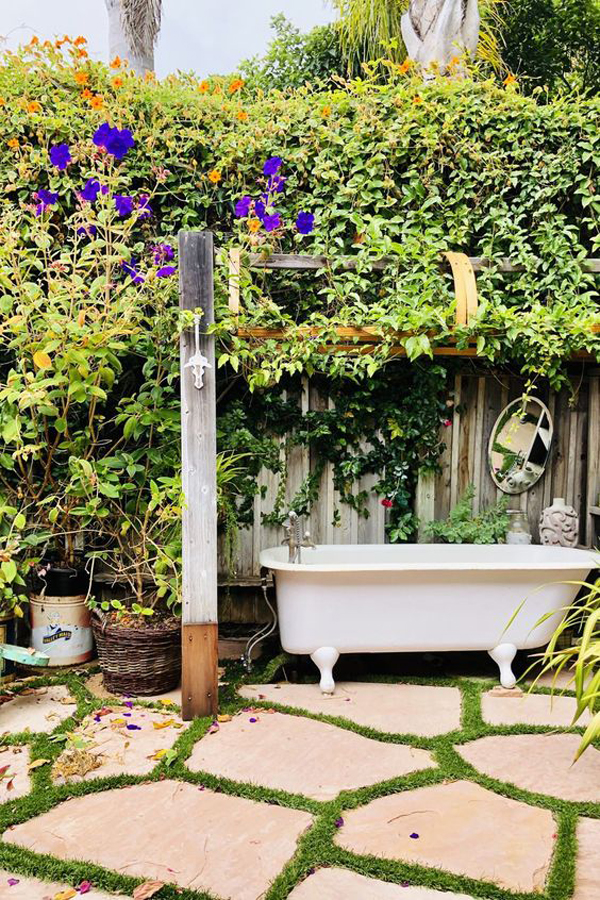 outdoor-shower-and-soaking-tubs-with-vines-garden