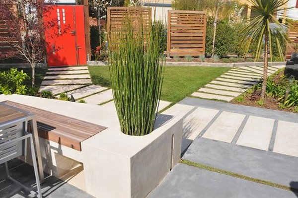 garden-bench-with-horsetail-reed-plants