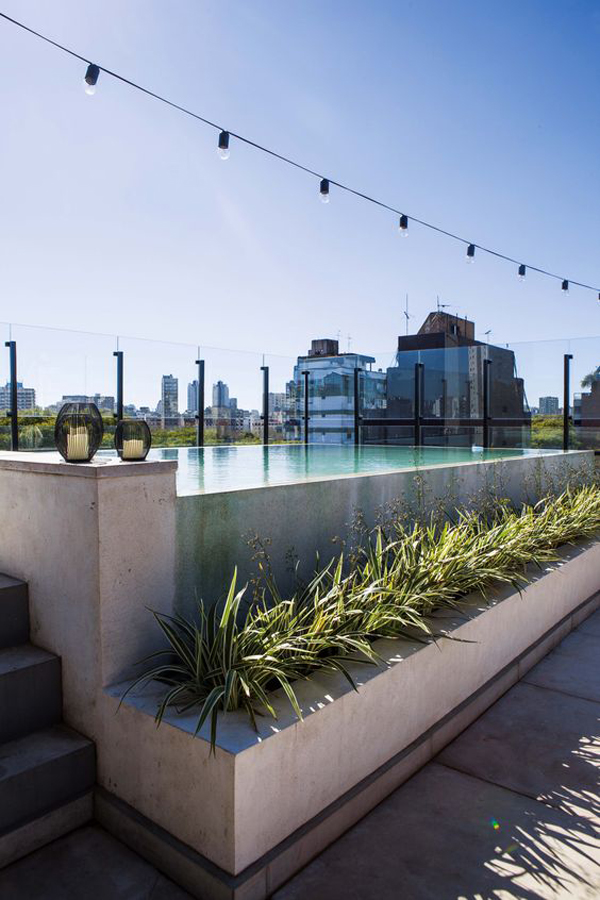 stone-rooftop-swimming-pool-with-glass-barrier