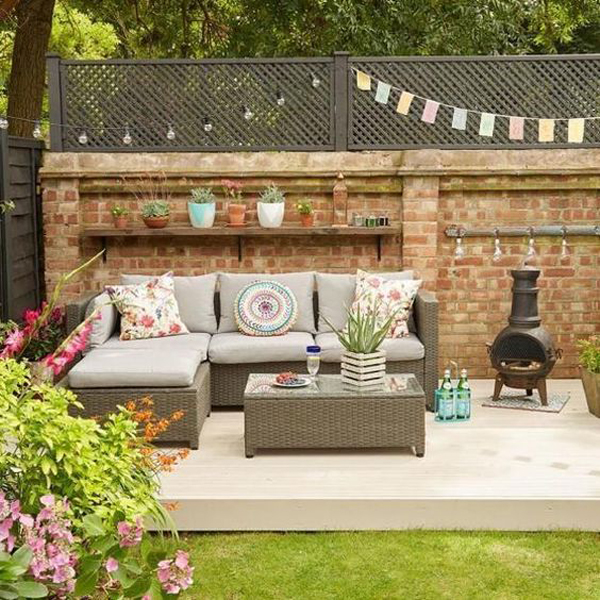 creative-decking-garden-with-outside-living-and-brick-exposed
