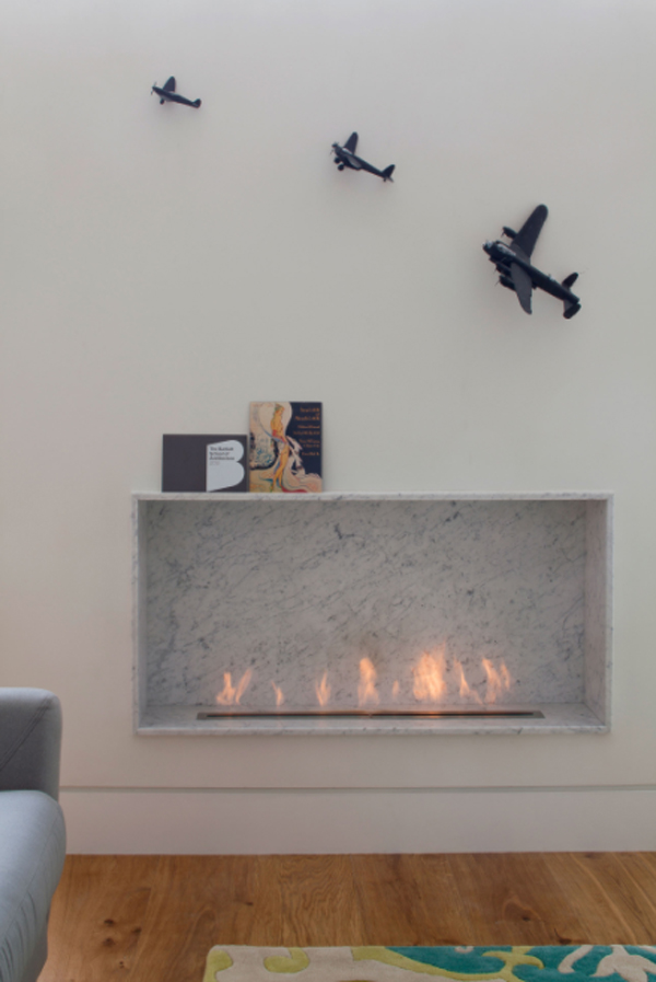 modern-fireplace-with-plane-toys-wall