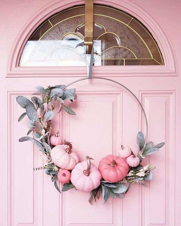 pink-halloween-door-with-pumpkin-wreaths